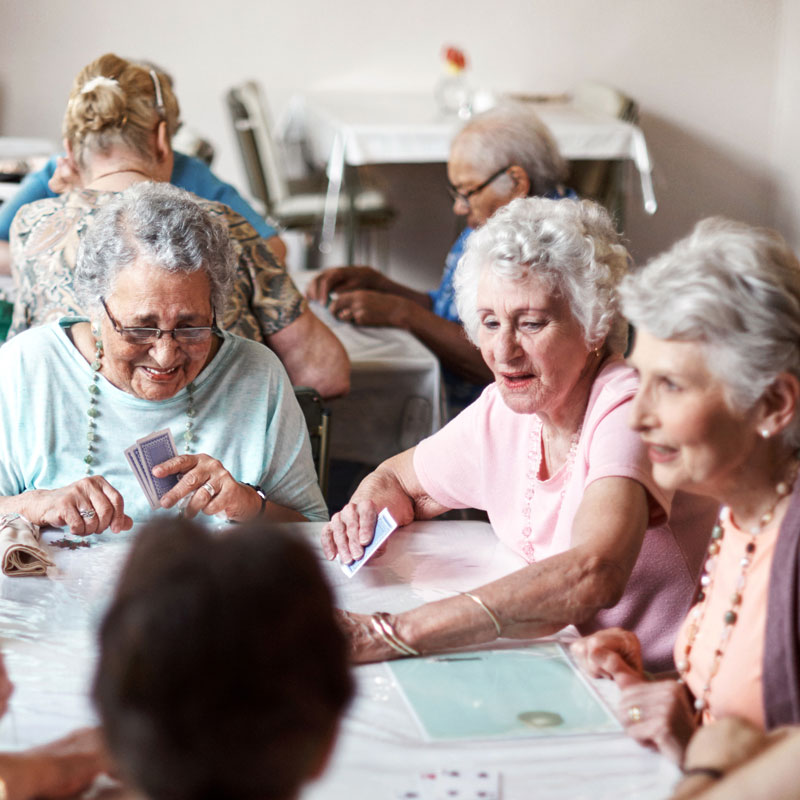 group of senior woman playing cards